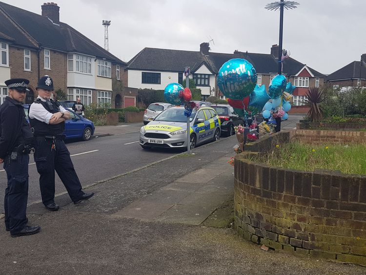 The family of burglar Henry Vincent, who was fatally stabbed when he broke into a pensioner's home, have marked his 38th birthday with balloons and flowers at the scene.