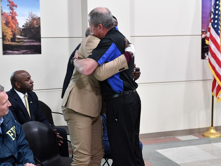 James Shaw (l) is embraced by the Waffle House President Walt Ehmer