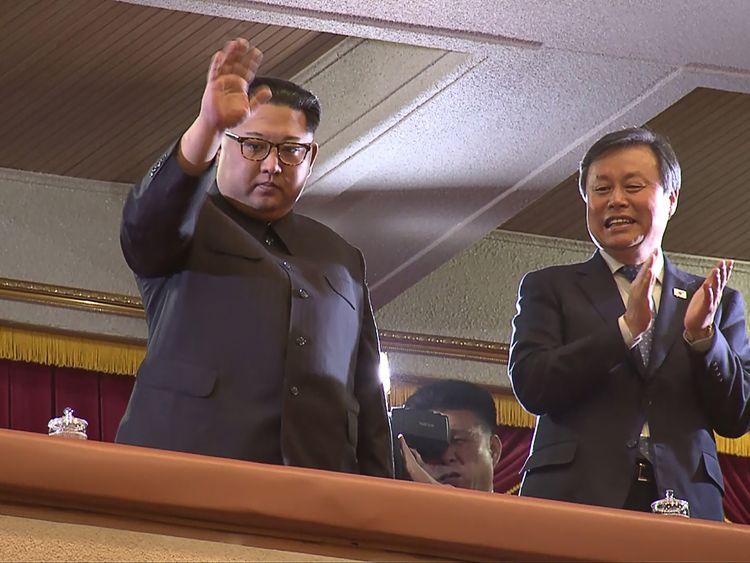 Kim Jong Un and South Korea's Culture minister Do Jong-whan watch the show
