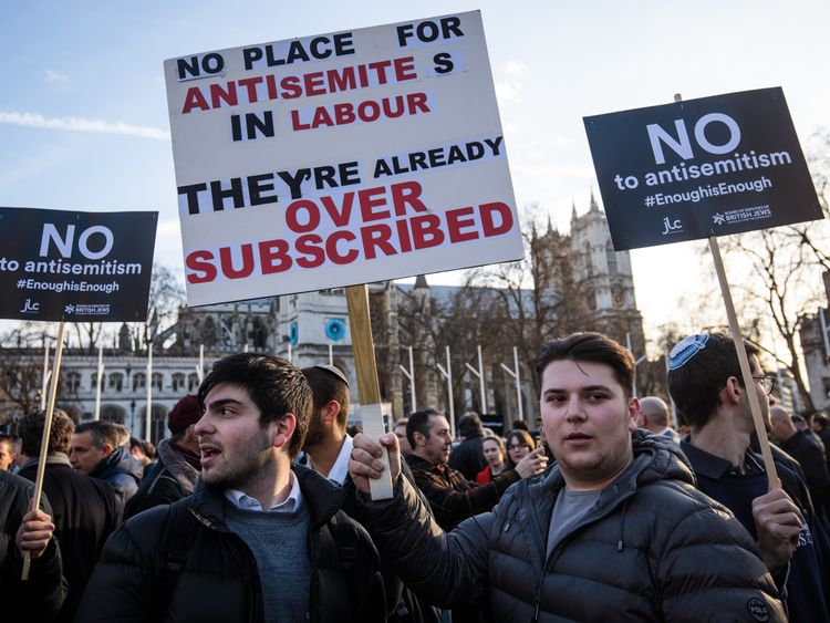 MARCH 26: Protesters hold placards as they demonstrate in Parliament Square against anti-Semitism in the Labour Party on March 26, 2018 in London, England.