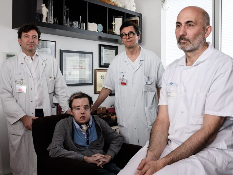 French medicine professor Laurent Lantieri (right) with members of his team and patient Jerome Hamon