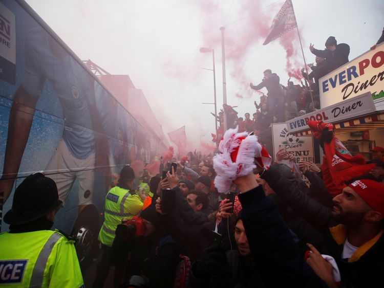 Liverpool fans react as the Manchester City bus arrives