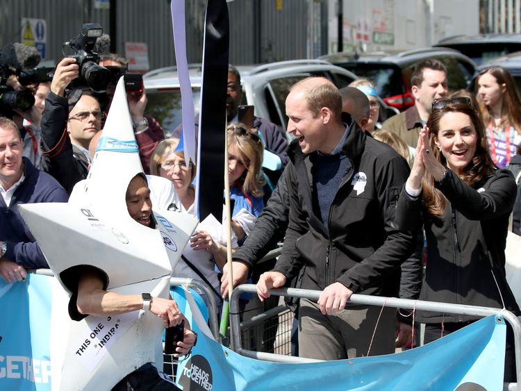 Catherine, Duchess of Cambridge, Prince William, Duke of Cambridge and Prince Harry hand out water to runners during the 2017 Virgin Money London Marathon on April 23, 2017 in London, England. The Duke and Duchess of Cambridge and Prince Harry, are spearheading Heads Together, in partnership with eight leading mental health charities, that are tackling stigma, raising awareness, and providing vital help for people with mental health problems.