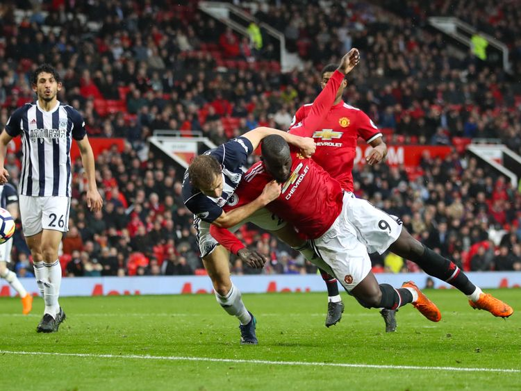 Manchester United's Romelu Lukaku and West Bromwich Albion's Craig Dawson battle for the ball during the Premier League match at Old Trafford, Manchester