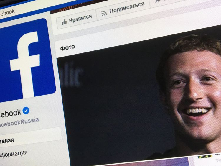 A picture taken in Moscow on March 22, 2018 shows an illustration picture of the Russian language version of Facebook about page featuring the face of founder and CEO Mark Zuckerberg. A public apology by Facebook chief Mark Zuckerberg, on March 22, 2018 failed to quell outrage over the hijacking of personal data from millions of people, as critics demanded the social media giant go much further to protect privacy. / AFP PHOTO / Mladen ANTONOV (Photo credit should read MLADEN ANTONOV/AFP/Getty Im