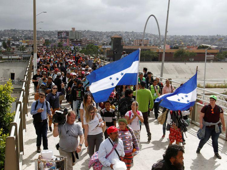 300 asylum seekers crossed the bridge in Tijuana to the US border