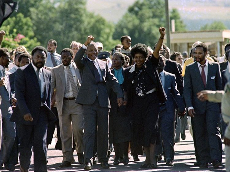 Mandela is pictured with her husband after his release from prison