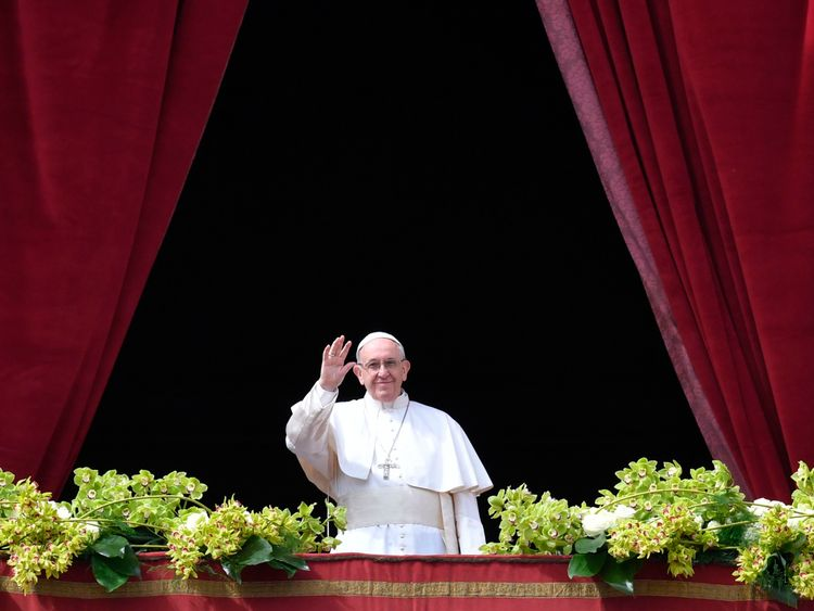 Pope Francis waving from the balcony of St Peter's basilica