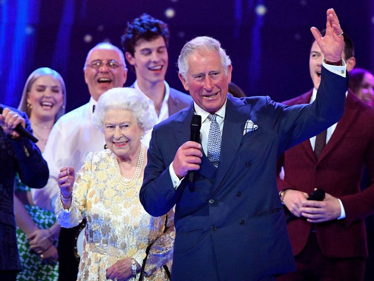 Prince Charles leads the cheers for Her Majesty