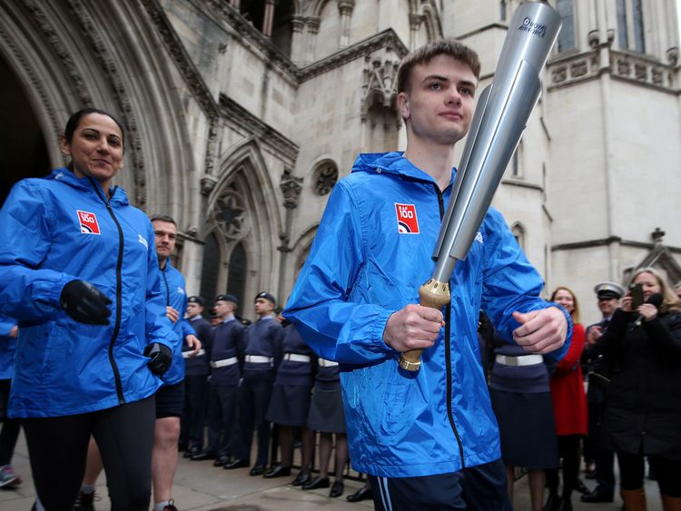Adam Wood, who read out the Queen's message, with the RAF100 Baton