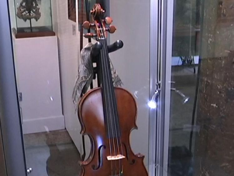 Russell Crowe's guitars and vintage violin go under the hammer