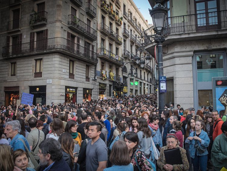 """BARCELONA, CATALONIA, SPAIN - 2018/04/26: Barcelona joins the protests in different Spanish cities for the resolution of a multiple violation trial in the last San Fermin celebration, on July 2017. A girl, 18 years old, was forced to have sex with a team of friends (5 men) called himselfs as """"La Manada"""" and fell in shock. She was recorded in different videos they send to their friends, and they leave the girl naked and without her mobile to call someone for help. The case became mediatic and the resolution has been too benevolent with the 5 boys and very unpopular, mostly for women who claim their right to go alone without being sexually assaulted. This case is added to another one of rape and murder in San Fermin years before. The killer is in probation and working as a psychologist after only few years. (Photo by Laura Calonge/SOPA Images/LightRocket via Getty Images)"""