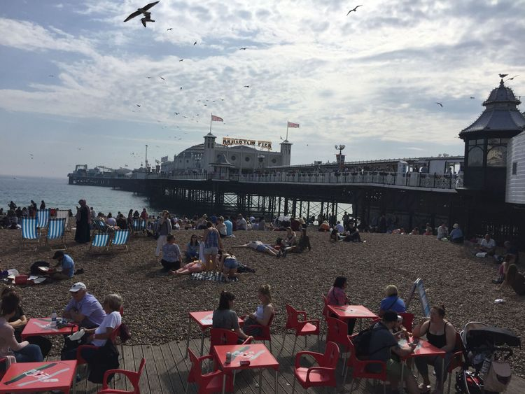 People flocked to the beach next to Brighton pier as the warm weather continued