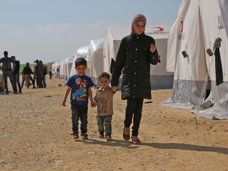 Children at a camp for displaced Syrians from Douma