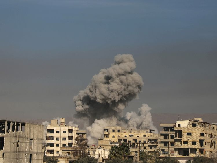 A general view shows smoke billowing in Hazeh in the rebel enclave of Eastern Ghouta on the outskirts of Damascus on March 15 2018