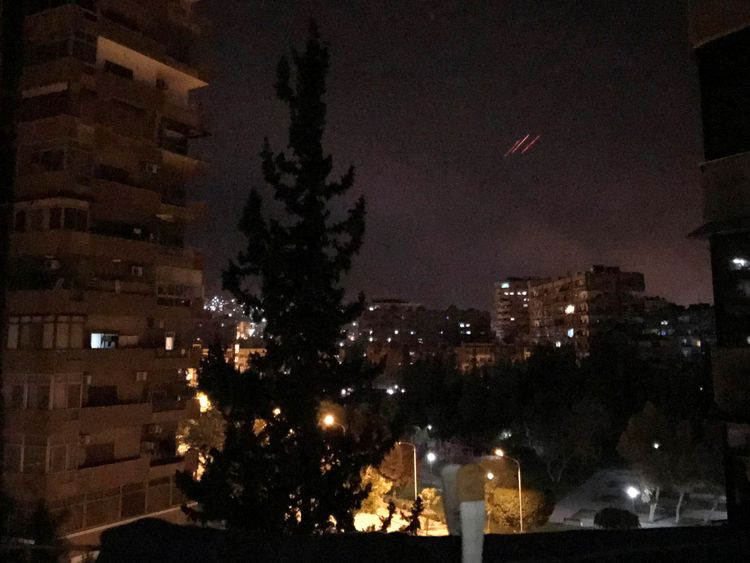 Anti-aircraft fire is seen over Damascus as the US, UK and France launch airstrikes