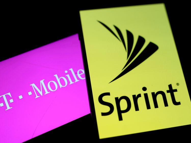 FILE PHOTO: Smartphones with the logos of T-Mobile and Sprint are seen in this illustration taken September 19, 2017