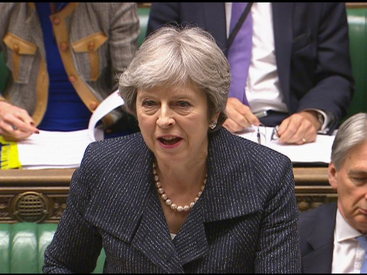 May laughs at Corbyn's resignation demand