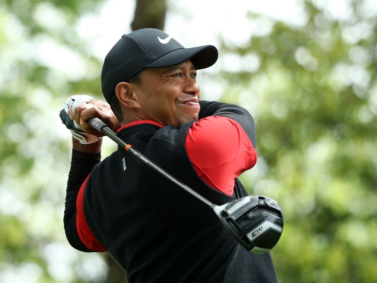 Tiger Woods hits off the second tee during the final round of play