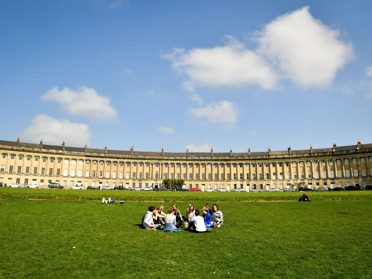 Friends enjoy a picnic in the sunshine in Bath on Saturday