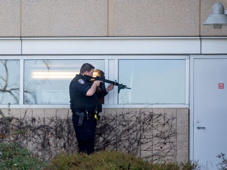 A police officer sweeps a building at YouTube's corporate headquarters