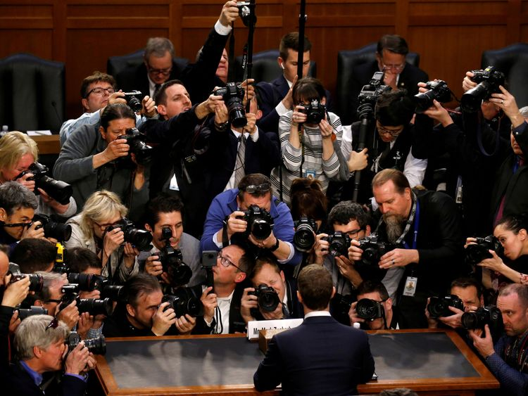Facebook CEO Mark Zuckerberg is surrounded by members of the media as he arrives to testify before a Senate Judiciary and Commerce Committees joint hearing regarding the companys use and protection of user data, on Capitol Hill in Washington, U.S., April 10, 2018. REUTERS/Leah Millis