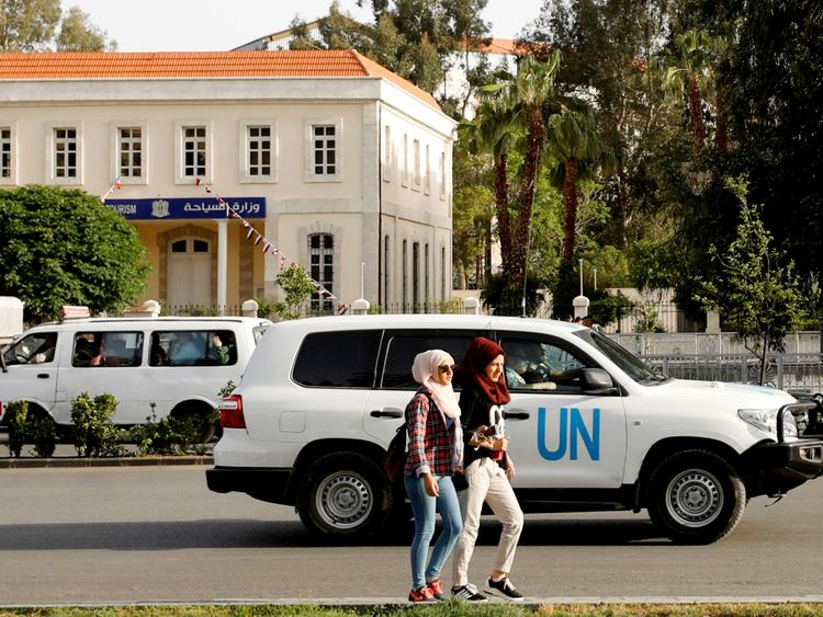 A UN vehicle carrying OPCW inspectors in the Syrian capital of Damascus