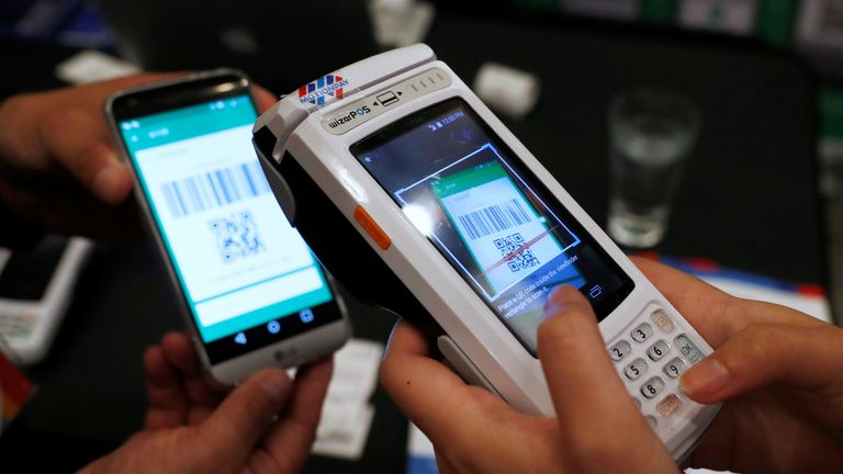 A device allowing customers to pay in Chinese yuan using WeChat Pay and Alipay using a QR code
