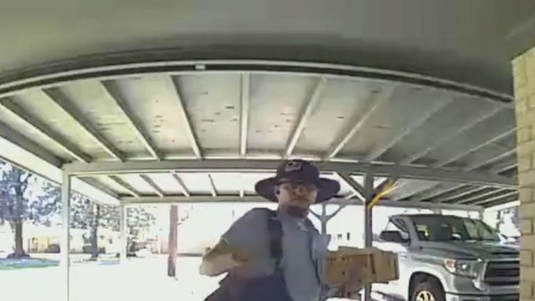 Postman dances outside door in Texas
