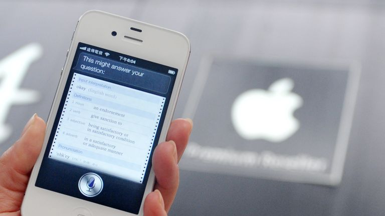A woman displays 'Siri', voice-activated assistant technology, on an Apple iPhone 4S in Taipei on July 30, 2012. Taiwan's National Cheng Kung University has filed a suit against US tech giant Apple, claiming the company's Siri intelligent assistant has infringed on two of its patents. AFP PHOTO / Mandy CHENG (Photo credit should read Mandy Cheng/AFP/GettyImages)