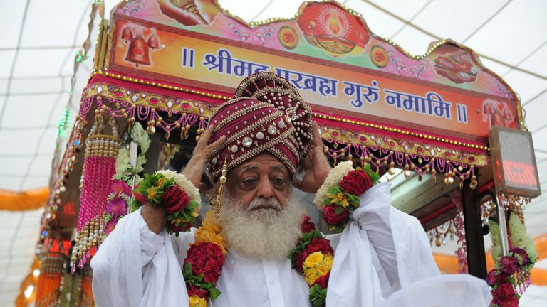 The self-styled godman blesses followers from atop a makeshift trolley in 2013