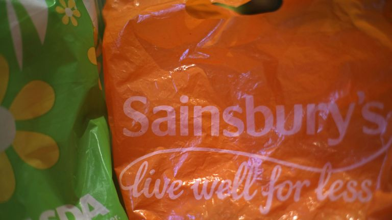 File photo dated 28/04/18 of shopping bags from Asda and Sainsbury's, as the competition watchdog is being urged to investigate the possible merger of the two supermarket retailers amid concerns over consumer choice.