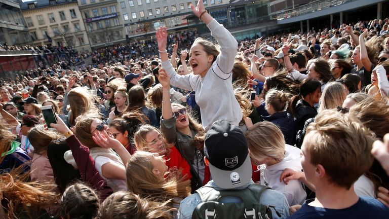 Hundreds of fans of Avicii gather to honour him at Sergels Torg in central Stockholm, Sweden April 21, 2018
