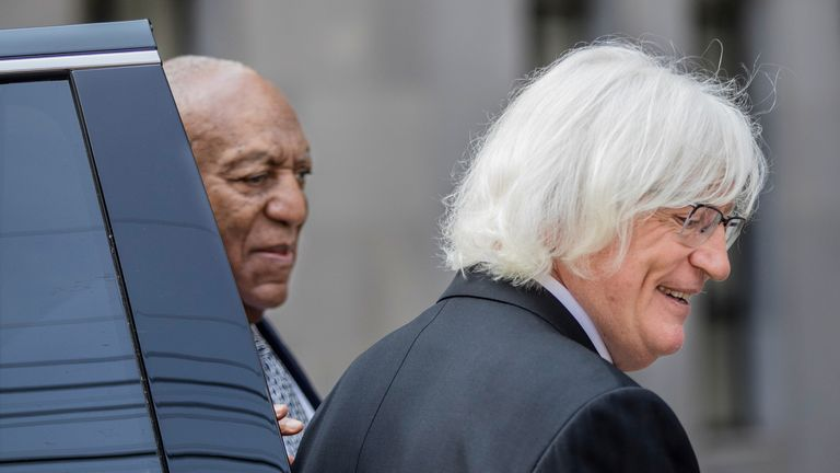 Bill Cosby (L), and his new attorney, Tom Meserau share a moment outside Montgomery County Courthouse in Norristown, Pennsylvania., U.S. August 22, 2017