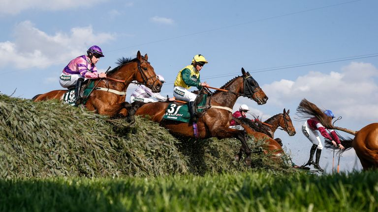 LIVERPOOL, ENGLAND - APRIL 14:  Bryony Frost riding Milansbar (C, yellow/green) on their way to finishing in 5th place in The Randox Health Grand National Handicap Steeple Chase at Aintree racecourse on April 14, 2018 in Liverpool, England. (Photo by Alan Crowhurst/Getty Images) *** Local Caption *** Bryony Frost;Milansbar