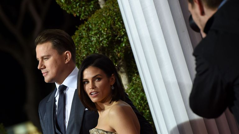 Actors Channing Tatum and Jenna Dewan-Tatum arrive at The Universal Premiere of Hail, Caesar! at the Regency Village Theatre, in Westwood, California, February 1, 2016 / AFP / Valerie Macon (Photo credit should read VALERIE MACON/AFP/Getty Images)