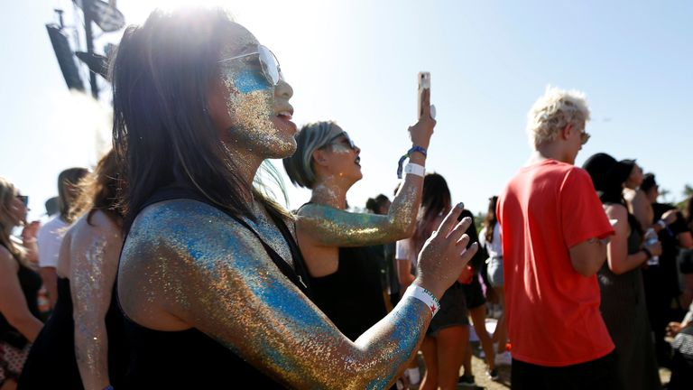 Concertgoers watch a performance by Nile Rodgers at the Coachella Valley Music and Arts Festival in Indio