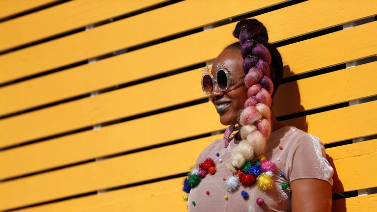 A concertgoer poses at the Coachella Valley Music and Arts Festival in Indio