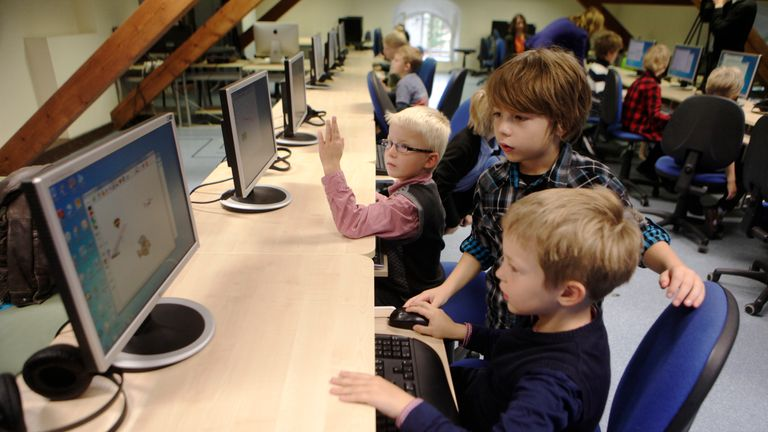 """First grade students learn simple coding during a computer lesson in school in Tallinn September 25, 2012. Estonian Tiger Leap Foundation has launched a program called """"ProgeTiiger"""" where Estonian students will be introduced to computer programming and creating web and mobile applications. According to representatives from the foundation, the program will start with students in the first grade, which starts around the age of 7, and will continue through a student's final years of public school,"""