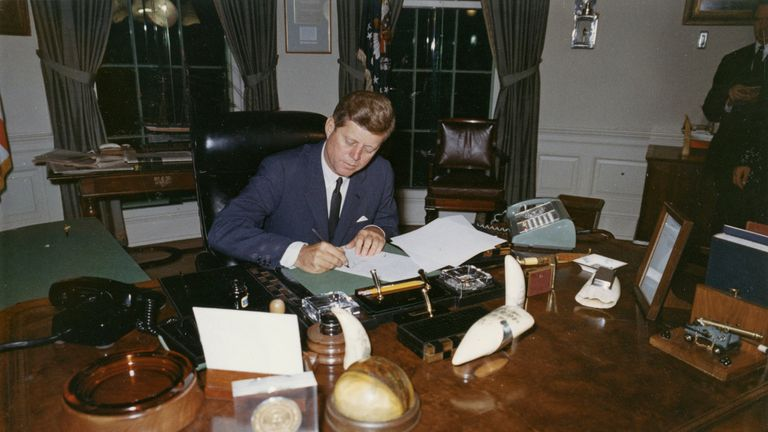 President John F Kennedy signing a proclamation for the interdiction of the delivery of offensive weapons to Cuba during the Cuban missile crisis in 1962