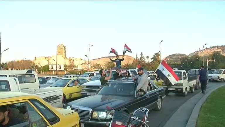 Syrians were celebrating defying the UK, US and France's strikes