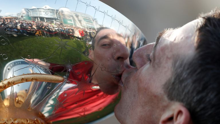 Davy Russell kisses the trophy as he celebrates winning the 17:15 Randox Health Grand National Handicap Chase    Action Images via Reuters/Matthew Childs