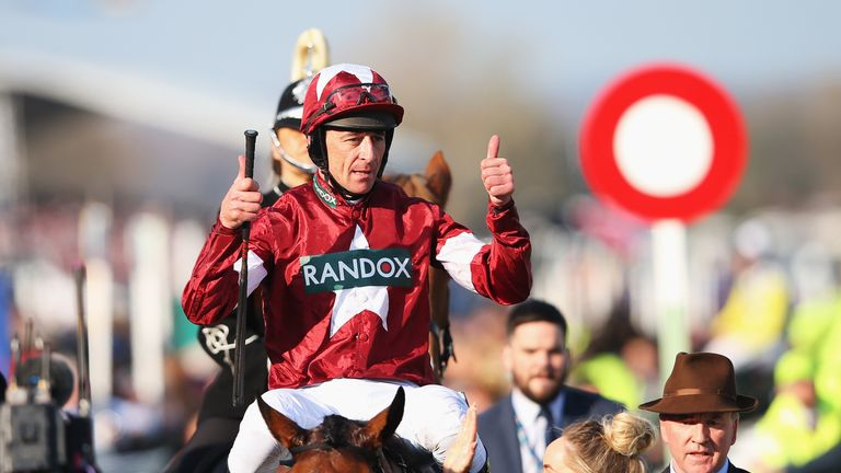 LIVERPOOL, ENGLAND - APRIL 14:  Davy Russell celebrates after riding Tiger Roll to victory during the 2018 Randox Health Grand National at Aintree Racecourse on April 14, 2018 in Liverpool, England.  (Photo by Alex Livesey/Getty Images)