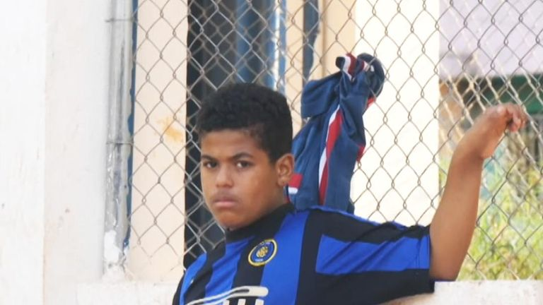 For families living in Brazil's  many slums or favelas, getting their child a break in football is a more realistic dream than getting them educated.