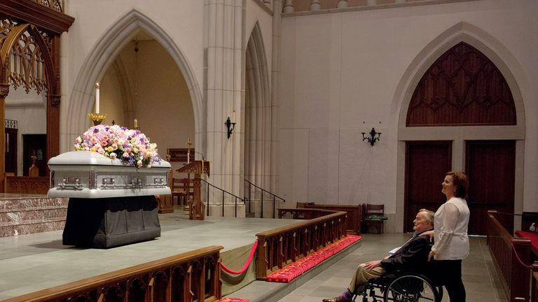 """Former President George H. W. Bush looks at the casket with his daughter Dorothy """"Doro"""" Bush Koch"""