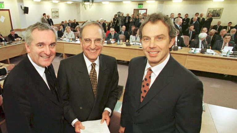 Former prime minister Tony Blair (R), US Senator George Mitchell (C) and Irish Prime Minister Bertie Ahern (L) smiling after signing the Good Friday agreement