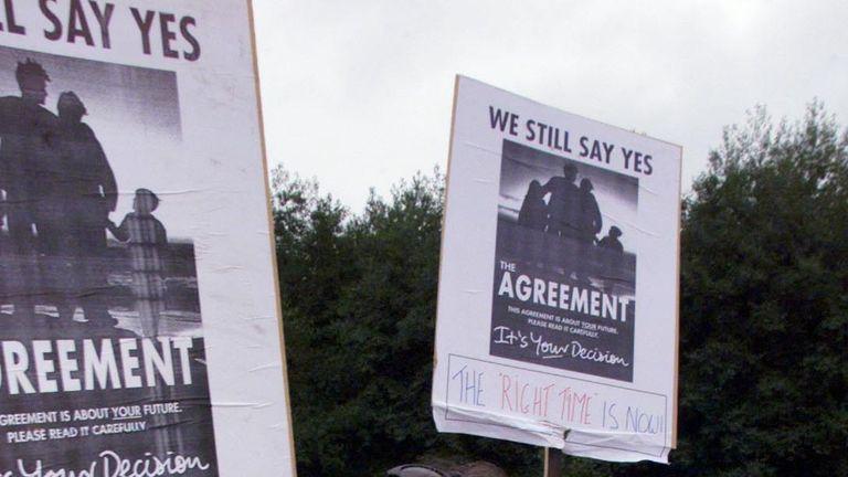 Pro Agreement supporters shout support to politicians arriving outside Castle Buildings Belfast, before the start of the Mitchell review of the Good Friday Agreement.