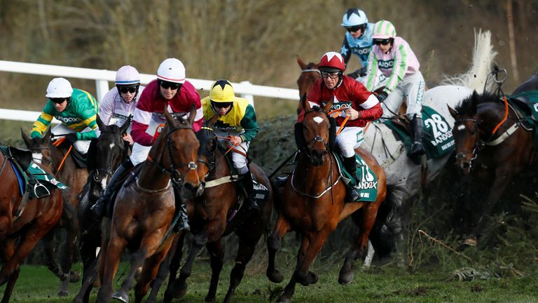 April 14, 2018 Tiger Roll ridden by Davy Russell (R) in action at Canal Turn before winning the 17:15 Randox Health Grand National Handicap Chase Action Images via Reuters/Jason Cairnduff