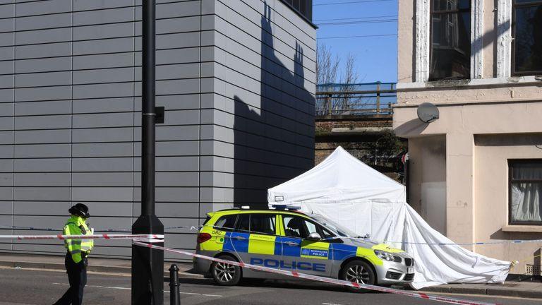 Police at the scene in Hackney, east London where a man in his 20s died after being stabbed