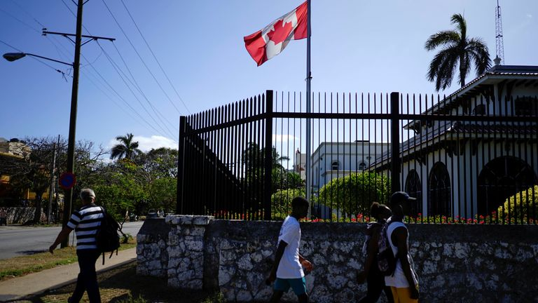 People pass by Canada's Embassy in Havana, Cuba, April 16, 2018
